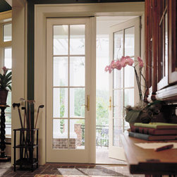 Hinged French Doors - Colonial grill patterned hinged French doors make an enticing entrance to a backyard.