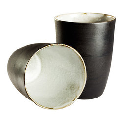 Black and White Tumblers - Set of 2 - The clean lines of these beautiful earthenware tumblers are elegant and modern.  Each is slip-cast by hand in black clay and the outside is left unglazed, offering a unique tactile and visual contrast between the matte exterior and the light glossy white interior.  Fired at stoneware temperature, they are food-safe, dishwasher and microwave safe. The nature of the clay and Diana's technique make each item distinctly unique, giving each a personality of it's own.  Handmade in South Africa.