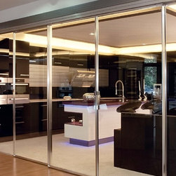 Sliding Doors - SLIDING DOOR SYSTEM WITH AN ELEGANT, SLIM PROFILE. SLIDING DOORS ARE MOUNTED WITH HUGE, UNDIVIDED TRANSPARENT OR SEMI-TRANSPARENT SAFETY GLASSES.