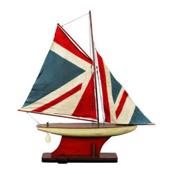 "Union Jack Pond Yacht - The Union Jack Pond Yacht measures 30.75"" x 5.5"" x 34.5"". The sails are sewn and hand finished. They represent cuttings of old nautical country flags and pennants. The inlaid wood strip deck offers more detail than a standard model ship deck. The non-toxic paint makes for a great kid's den or bedroom accessory."
