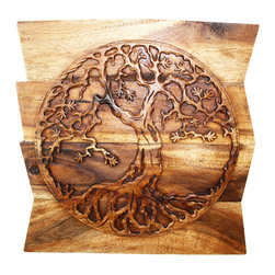 Kammika - Tree of Life Round on Uneven Boards Sust Wood Wall Panel 24x24x2 inch Eco Walnut - Our Sustainable Monkey Pod Wood with Eco Friendly Natural, Food-safe Livos Walnut Oil Finish Tree of Life Round on Uneven Boards is a 24 inch x 24 inch x 2 inch thick Wall Panel that displays the concept of a many branched tree illustrating the idea that all life on earth is related. The Banyan and the Peepal trees are both considered the Trees of Life. The Banyan symbolizes fertility; it is also referred to as the Tree of Immortality. Each panel is hand carved - no two are alike. Craftspeople from the Chiang Mai area in Northern Thailand create these pieces with the simplest of tools. After each Monkey Pod wood (Acacia, Koa, Rain Tree grown for wood carving) piece is dried, carved and sanded by Thai artisans, it is rubbed in natural food-safe eco friendly Livos Walnut Oil that is polished to a water resistant and food safe matte finish. Color range is from medium to dark Walnut brown tones that will darken as the wood ages. These natural oils are translucent, so the wood grain detail is highlighted. There is no oily feel; and cannot bleed into carpets, as it contains natural lacs. This piece is made from the branches of the Acacia tree in Thailand - where each branch is cut and carved to order (allowing the tree to continue growing). The wood is dried, carved and sanded by Thai artisans. We make minimal use of electric sanders in the finishing process. All products are dried in solar or propane kilns. No chemicals are used in the process, ever. This eco friendly piece is packaged with cartons from recycled cardboard with no plastic or other fillers. The color and grain of your piece of Nature will be unique, and may include small checks or cracks that occur when the wood is dried. Sizes are approximate. Products could have visible marks from tools used, patches from small repairs, knot holes, natural inclusions or holes. There may be various separations or cracks on your pi