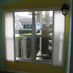 Vertical Cellular Shades in Lanai - This photo shows the shade on the lanai side window partially opened. Again, each side works indepentally.