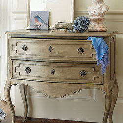 Galiena Two Drawer Console - This refined double drawer chest would be right at home bedside but equally at ease in the living room. Four feminine curved legs, an ogee-edged top, hand-cut apron and delicate keyholes add to its authentic French charm. Eye-catching accents include raised molding on the drawers and brass hardware. Solid poplar is wire-brushed, then painted, and sanded again. This time-honored French finishing method results in the look of an heirloom.