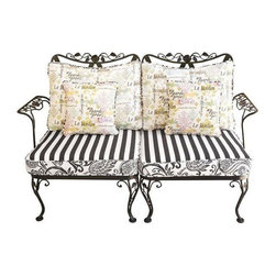 Pre-owned Outdoor/Indoor French Country Style Woodard Settee - A vintage French Country style Woodard indoor/outdoor settee. The frame is made of high gloss wrought iron and the cushions feature graphic black and white prints. The set includes two reversible pillows with colored motifs and French calligraphy.    A matching wrought iron side table is available separately. Please see other listings.