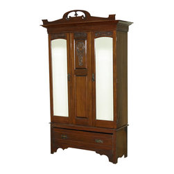 Antiques - Antique English Large Walnut Armoire Wardrobe Closet c1899 - Country of Origin: England Circa 1899 Antique Walnut Finish Beveled Edge Mirrors Solid Wood Construction Six Aged Brass Colored Hooks Coat of Arms Design on Middle Panel Sturdy Feet Large Lower DrawerThis is a wonderful antique walnut armoire wardrobe with beveled edge mirrors, aged brass colored handle pulls, and ornate wood carvings. The walnut panel in the middle has a coat of arms design and awaits your family crest. There are 6 brass colored hooks on the inside to hang coat and jackets. The piece has a molded crown and rests on bracket feet with a scalloped skirt. There is one key present and it will lock the left door only.  The drawer misses the right handle pull and comes down when fully open.  The armoire tends to lean slightly forward when fully open. It has age appropriate signs of wear including scratches, scuffs and separations but overall it is in very good condition for its age c1899. (In Inches)Interior Dimensions: 52H x 42W x 15DInterior Dimensions of Drawer: 8.5H x 39W x 13.75D