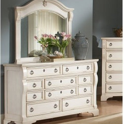 Heirloom 10 Drawer Dresser - Antique White - The Heirloom 10 Drawer Chest-Antique White gives your living space a timeless look that can be handed down through the generations. It is constructed of select hardwoods and quality veneers in a distressed antique white finish with rub-through highlights. From the wood molding on the drawer fronts to the brushed pewter ring pulls, this chest of drawers accents your decor with a classic, functional style. It has ten spacious, center-guided drawers with positive drawer stops for smooth and quiet function. The drawers feature English dovetail construction and fully-finished interiors for a lifetime of snag-free use. A package option includes a matching mirror that adds light and space to any room. Choose dresser only, or dresser and mirror.About American WoodcraftersFor unparalleled quality and value, choose American Woodcrafters for your youth or master bedroom furniture. Founded in 1996 as a division of Rockford Capital Corporation and located in High Point, N.C., American Woodcrafters is the brainchild of John N. Foster. His 40 years of experience in manufacturing, marketing, and product development inspire the company to deliver superior furniture designs of exceptional value. Each exquisite furniture piece is well-made and creatively styled, with a fine quality finish and innovative features to make your home more beautiful and functional.