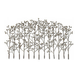 Iron Trees Wall Sculpture - The easy-to-coordinate champagne silver finish of this Iron Trees Wall Sculpture gives a slightly, beautifully aged look to the expressive, ephemeral slenderness of the dimensional metal artwork. With your wallpaper or paint color visible between the slim trunks of the stylized trees in this grove, the look is remarkably light and, with the plump berries that terminate the twigs, subtly bountiful.