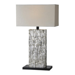 Santa Fe Table Lamp - The body of the Santa Fe lamp is rich and refined with its aged silver leafing and exquisite bark like texture. Finished with a trimless off white linen shade and black base. Light bulb not included.