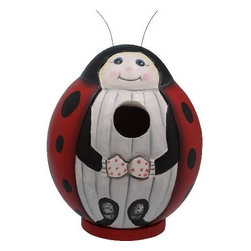 Songbird Essentials - Ladybug Gord-O Birdhouse - Songbird Essentials adds color and whimsy to any garden with our beautifully detailed wooden birdhouses that come ready to hang under the canopy of your trees. Hand-carved from albesia wood, a renewable resource, each birdhouse is hand painted with non-toxic paints and coated with polyurethane to protect them from the elements. By using all natural and nontoxic components Songbird Essentials has created a safe environment complete with clean-out for our feathered friends.
