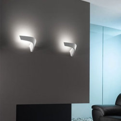 """Icone Luce - Icone Luce Boomerang AP wall lamp - The Boomerang AP wall lamp from Icone Luce was designed by Marco Pagnoncelli in 2009. This contemporary wall lamp made in Italy is an indirect light in die-cast aluminium. The structure of Boomerang AP fixture is finished in polished aluminium, aluminium and white. Illumination is provided by one R7s 118mm, 1x300W halogen (not included).      Product Details:  The Boomerang AP wall lamp from Icone Luce was designed by Marco Pagnoncelli in 2009 This contemporary wall lamp made in Italy is an indirect light in die-cast aluminium. The structure of Boomerang AP fixture is finished in polished aluminium, aluminium and white. Illumination is provided by one R7s 118mm, 1x300W halogen (not included).  Details:     Manufacturer: Icone Luce   Designer: Marco Pagnoncelli   Made in: Italy   Dimensions:  Height: 7.9""""(20cm) X Length: 12.6""""(32cm) X Depth: 6.5""""(16.5cm)     Light bulb:  R7s 118mm, 1x300W halogen (not included)     Material: Metal"""