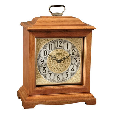 Hermle Clocks - Ashland American Style Mantel Clock in Oak Finish w Top Handle - A timeless time-teller for your casual surroundings, this elegantly proportioned Ashland mantel clock shows refined craftsmanship at every turn. Rectangular clock has hardwood construction with a warm oak finish. Easy to read black Arabic indicators are offset with a two-tone dial. Classic Oak finish. Rich embossed metal dial. Black Arabic numerals. Mechanical Westminster movement. 26 in. W x 14.5 in. D x 80.5 in. H
