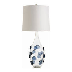Arteriors - Edge Lamp - There is nothing better than making a bold statement with the useful items in your home, and that includes lighting. The beautifully hand-embellished cobalt blue glass pieces attached to the glass bottle make this lamp a truly special piece. A tall white drum shade completes the look effortlessly.