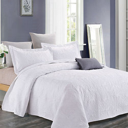 Duke Imports, Inc. - White Avery Quilt Set - Ornate patterns and cozy textures create an air of freshness, while durable construction ensures comfort night after night. A neutral color easily matches your bedroom décor.   Includes quilt and two shams 100% polyester Machine wash Imported
