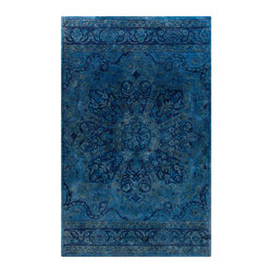 Mykonos Rug - Sky Blue, Teal, and Navy - 8' x 11' - The energizing composition of the Mykonos Rug - with a meditative oversized floral motif at the center and elegant scroll-framed borders at either short end - is second only to its powerful ocean color scheme for meditative, mood-setting effect. Suffused with shades of sapphire, this elegant rug is hand-tufted from pure wool for an unusually plush feel.