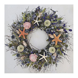 "Frontgate - Neptune's Garden Dried Wreath - 22"" dia. - Hand-assembled. Suitable for indoor or outdoor use in a covered area, away from the elements. All materials are grown in the USA. Bring the coast to your home with our Neptune's Garden Dried Wreath. A medley of air-dried quailbrush, echinops, dark and light blue larkspur and avena create a base for assorted shells, starfish, and sea urchins to mingle.  .  .  . Made in the USA."