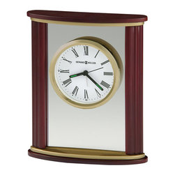 Howard Miller - Howard Miller Victor Quartz Alarm Table Clock - Howard Miller - Mantel / Table Clocks - 645623 - This attractive contemporary table alarm clock offers a flourish of charm for your desktop or mantel and is sure to be admired. Distinguished by its contoured hardwood sides floating dial in glass center panel and satin brass crown and base plates the Victor is easily admired. A protective full felt bottom and the reliability of battery-operated quartz alarm movement complete the appeal of the Victor Alarm Table Clock.