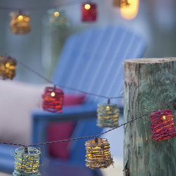 Multicolored Vine Outdoor Solar String Lights - You'll need to light the way so that the fairies see you from high above the earth. This cute string of lights is solar powered.