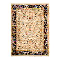 Safavieh - Tilda Rug, Cream / Navy 8' X 11' - Construction Method: Power Loomed. Country of Origin: Turkey. Care Instructions: Vacuum Regularly To Prevent Dust And Crumbs From Settling Into The Roots Of The Fibers. Avoid Direct And Continuous Exposure To Sunlight. Use Rug Protectors Under The Legs Of Heavy Furniture To Avoid Flattening Piles. Do Not Pull Loose Ends; Clip Them With Scissors To Remove. Turn Carpet Occasionally To Equalize Wear. Remove Spills Immediately. The dramatic patterns of heirloom Serape, Sultanabad and Oushak rugs are recreated for 21st century lifestyles in the Austin Collection. Power-loomed of long-wearing, easy-care polypropylene, each rug stands up to heavy traffic while adding timeless beauty to entry hall, living room, kitchen and more.
