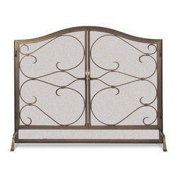 Iron Gate Arched Operable Door Screen - This pair of massive and fully functional doors frames a slender pattern of decorative scrollwork, the twists and curves of which are sure to draw the eye of any wintertime guest.