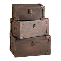 Yuma Trunks  - Set of 3 - The appeal of vintage luggage in the eclectic interior comes with the style's allusion to travel and its sense of the found and salvaged.  The Set of Three Yuma Trunks contributes all this evocative potential, but replaces often hard-to-match color with a high-end transitional standby: patina metal and industrial-feeling hardware that complement objects and fragments treasured by decorators.