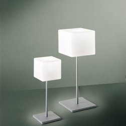 """Itre - Cubi Table Lamp - Classic cube shape in blown, satin white glass highlights this clean and simple family of designs. Wall / ceiling, suspension, wall, table and floor models are available. FEATURES: -Table Lamp. -Cubi collection. -Designed by Ufficio Stile I Tre. -White diffuser. -Grey structure. -Satin white glass highlights. SPECIFICATIONS: -Accommodates 100 watt DC bayonet halogen bulb. -Overall dimensions: 17.75"""" H x 6.25"""" W x 6.25"""" D. Designed by: UFFICIO STILE I TRE"""