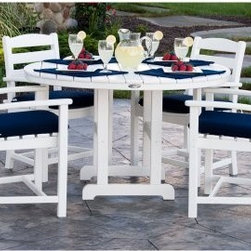 POLYWOOD® La Casa Cafe Dining Set with Cushions - Seats 4 - White / Navy - Whether your guest of honor is a legislator or an in-law, POLYWOOD La Casa Cafe Dining Set with Cushions - Seats 4 - White / Navy is made to impress now, and a decade from now, in durable, eco-friendly POLYWOOD. Your guests will relax in comfort in four white La Casa Cafe Dining Arm Chairs around the 48 inch table. Weather and fade-resistant navy cushions are included to make this a comfortable setting where guests will want to linger. Constructed of solid POLYWOOD recycled lumber that won't splinter, crack, chip or rot; you won't ever need to paint, waterproof, or stain to keep this set looking great. You know what insects, fungi, or ocean spray can do to wood, but POLYWOOD can take the abuse, and even resists stains from wine, barbeque sauce, and more. Go ahead and hose it down if things get messy. The manufacturer will even put their money where their mouth is by offering a 20-year limited residential warranty on this set, or a 1-year limited warranty for commercial use. POLYWOOD furniture is made in the USA.About Poly-WoodThe advantages of Poly-Wood Recycled Plastic are hard to ignore. Poly-Wood absorbs no moisture and will NOT rot, warp, crack, splinter, or support bacterial growth. Poly-Wood is also compounded with permanent UV-stabilized colors, which eliminates the need for painting, staining, waterproofing, stripping, and resurfacing. This material is impervious to many substances, including salt water, gasoline, paint, stains, and mineral spirits. In addition, every Poly-Wood product comes with stainless steel hardware.Poly-Wood is extremely easy to clean and maintain. Simple soap and water is all you need to get rid of dirt and make your furniture look new again. For extreme cleaning needs, you can use a 1/3 bleach and water solution. Most Poly-Wood furnishings are available in a variety of classic colors, which allow you to choose your favorite or coordinate with the furniture you already have. This is sure to be a piece that you will be proud to own for a lifetime.