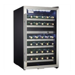 "Danby - 38 bottle wine cooler, black cabinet with stainless steel door frame - Stores up to 38 bottles of wine in two distinct, separately regulated temperature zones for red and white wine storage. Depending on your preference, the upper and lower temperature zones can be set for either white or red wine temperatures. Programmable temperature range of 39.2 degrees F - 64.4 degrees F (4 degrees C - 18 degrees C). Two white LED interior lights beautifully showcase the wine without the heat of an incandescent bulb. The white LED thermostat is easily viewed through the door. New stainless steel towel bar style handle adds a stylish touch. Stainless steel trimmed black wood shelves match the stainless steel exterior door. Convenient reversible door swing for left or right hand opening. The tempered dotted glass helps protect the wine from harmful UV rays. Unit dimensions 19 7/16"" W x 24 15/16"" D x 33 2/16"" H"