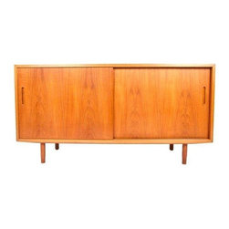 Used Small Danish Modern Teak Sideboard - By Hundevad, Denmark comes this compact sideboard with 2 adjustable shelves & one felt lined drawer. Perfect candidate to house your media components. Accented with nice tapered legs in true Mid-Century fashion.
