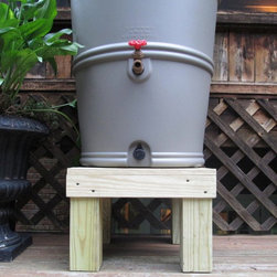 Rain Barrel Company - Rain Barrel Company Chesapeake Rain Barrel Stand Multicolor - RBD500 - Shop for Watering Equipment from Hayneedle.com! The Rain Barrel Company Chesapeake Rain Barrel Stand is hand-crafted of environmentally sensitive pressure-treated southern pine. It features a slatted top with 1-inch spaces and stands 12 inches high. With this stand accessing the water in your rain barrel is easier and you'll find there's better water pressure. Let this stand weather for six weeks before sanding it and applying your favorite stain or paint.About The Rain Barrel Depot Owned by Gene and Peggy Kelly and located in the North Atlanta suburb of Norcross the people at the Rain Barrel Depot consider themselves to be in the people business. Their goal is to help people conserve water resources and be better stewards of the water resources they've been given. The Rain Barrel Depot wants to increase people's access to life's most basic necessity; clean water.