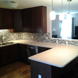 Solid Surface / Living Stone / Tile ready Splash - Solid Surface is a beautiful and very durable material that will give you kitchen a great look.