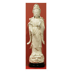 China Furniture and Arts - White Porcelain God of Mercy (1) - Kwan Yin is the goddess of mercy who, it is said, chose to stay on earth to help others reach enlightenment. Hand crafted in pure white porcelain, her delicate and expressive features suggest feelings of calm and peace. A perfect piece to add serenity to your environment.