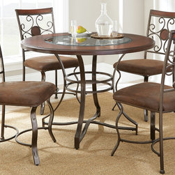 Steve Silver Furniture - Steve Silver Toledo 5 Piece Dining Room Set in Cherry - The Toledo table adds character and charm for any dining space. The 45 round dining table features beautiful cherry finished birch veneers and a beveled glass insert with decorative metal scrollwork and a faux leather medallion under the glass.
