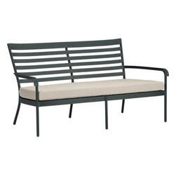 """Orleans Sofa with Sunbrella® Stone Cushion - Elegant French Provencal curves nod to streamlined midcentury modern in this gracious and timeless outdoor collection. Park bench-style seating takes shape in durable yet lightweight aluminum tubing, powdercoated in a classic shade of evergreen. Slatted back angles for leisurely relaxing in a softly rounded frame, complete with retro-inspired """"covered"""" armrests. Stone chair cushion is covered in fade- and weather -resistant Sunbrella® acrylic with fabric tab fasteners to hold it in place. Orleans dining collection also available."""