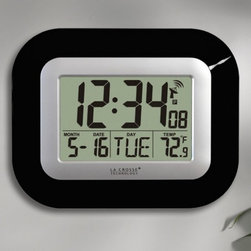 La Crosse Technology - La Crosse Technology WT-8005U - 9 in. Digital Atomic Wall Clock - WT-8005U-B - Shop for Clocks from Hayneedle.com! The La Crosse Technology WT-8005U - 9 in. Digital Atomic Wall Clock is a small wall clock that makes a big impression. The large high-contrast display is easily seen from across a room. Hang this clock on a wall or stand it on a desktop for convenient time date day and indoor temperature information from 14.1 to 139.8 degrees F (-9.9 to 59.9 degrees C). Atomic clocks work so accurately because they synchronize with the master clock at the U.S. Naval Observatory the official source of time for the U.S. Department of Defense. This contemporary wall clock automatically updates to daylight-saving time and features U.S. time zone selection for Eastern Central Mountain and Pacific time. Easy to set up accurate and reliable this timepiece comes in your choice of three colors: black white or silver. Measures 9W x 1D x 7.25H inches. Requires two AA batteries (not included). Expect battery life of up to 24 months. Includes instructions. About La Crosse TechnologyFounded in 1985 La Crosse Technology was the first company to introduce atomic timepieces to the consumer market. This multinational company sticks to its original small-town philosophy of providing customers with the highest level of service. Among their available products are radio-controlled timepieces wireless weather stations and other measuring devices. All La Crosse weather instruments clocks and watches are calibrated daily to the atomic time standard of the NIST.