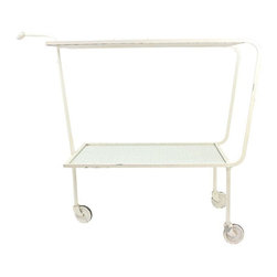 Used 1960's Mid-Century Modern Drink Cart - Super Mid-Century Modern bar cart! This is the perfect style for any room. It's on wheels so it's easy to move. Cute mod handle with round ball on the end. Set your favorite tea set on here for a beautiful display or set up those cocktails for your next party. Some wear on the white paint but overall very nice condition. One small chip on the inside on one piece of glass but not noticeable. The glass inserts easily come out.