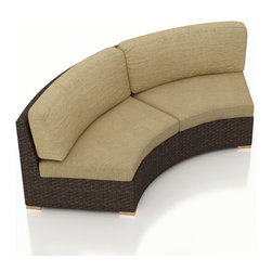 Harmonia Living - Arden Eclipse Outdoor Wicker Curved Loveseat, Tan Cushions - The Arden Eclipse Outdoor Wicker Curved Loveseat with Tan Sunbrella® Cushions (SKU HL-ARD-E-LS-CH-HB) brings a cozy, rustic appeal to modern outdoor furniture. Its beautiful wicker is finished with a weathered Chestnut finish and is made from High-Density Polyethylene (HDPE), which ensures that the wicker will neither fade nor peel in regular sun exposure. What makes the Arden Collection unique is its high arms, modern style, and extra-plush cushions, all with a hint of classic traditional looks. Its teak feet elevate the seats in an attractive fashion that accent the wicker. The cushions are made from Sunbrella fabric, which is available in a large assortment of shades to give your Arden set the look that fits right into your outdoor space.