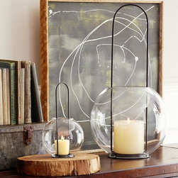 Sphere Globe Lanterns - The simple globe glass lantern gives a modern twist to an outdoor classic. I would love to have a few of these hanging outside around my patio.