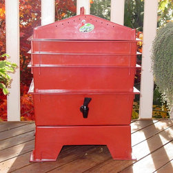 "VermiHut - VermiHut 3-Tray Recycled Plastic Worm Composter - Terra Cotta Multicolor - G9002 - Shop for Garden Equipment from Hayneedle.com! Product upgrade! This worm composter now features an organic compostable coconut fiber mat. This mat absorbs moisture and minimizes fruit flies. Who knew worms would be such lovely roommates? The VermiHut 3-Tray Recycled Plastic Worm Composter - Terra Cotta is worm heaven and they'll cheerfully go to work composting the kitchen waste you used to throw away. This odorless compact system is fast and efficient: start worms on the bottom shelf and they migrate up as they finish leaving behind the richest black dirt you've ever seen. Just pull out the bottom tray refill it with scraps and put it back on top. The included simple instructions are for you; the worms already know what to do. This 3-tray composter is made of terra cotta-colored high-density polyethylene durable and odor-proof. Worms aren't included but you can order them at checkout. We recommend starting with 1000 worms. Their numbers will grow fast because they're wallowing in the lap of worm luxury if worms had laps. Expect a colony of 3600 worms all working for you. How does it work?It's easy. Fill each tray with scraps: vegetables fruits egg shells coffee grounds and paper (yep junk mail is worm candy). Your worms will dig in happily silently odorlessly leaving behind the very best compost available for free. Your plants will go nuts. You don't have to sift through the wiggly workers because they've already moved up to the next tray. Super nutrient-rich moisture is captured in the drip tray the famous liquid fertilizer known by fans as ""worm tea."" Benefits of the VermiHut Worm ComposterOdorless: Breathe easy. Follow the easy instructions included and this natural process breaks down smelly garbage into rich black dirt fresh as a spring day.Compact: The trays stack taking up little space. No big tumbler no shoveling.Easy: No more running out to your composter to mix it up every week! The worms do the work for you recycling up to 5 pounds of food per week. They don't take nights off so you get compost faster a whole tray of nutrient-rich castings every month."