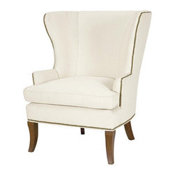 Dunstan Wing Chair by Ballard Designs - Hamptons style is all about mixing tailored and casual, and one way to do that is to combine your slipcovered sofa with oversized wingchairs in white linen and nailhead trim. Of course, these won't stand up to sandy feet and swimsuits, so a striped linen might be a better option.