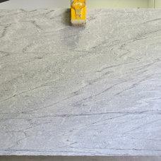 Modern Kitchen Countertops by Stone Center