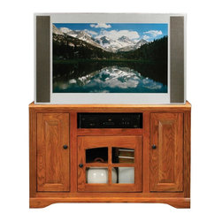 Eagle Industries - Oak Ridge 3 Doors TV Stand (Light Oak) - Finish: Light Oak. One glass panel door. Two raised panel doors. Two fixed wood shelves. Designed with decorative molding and fluted detailing. Warranty: Eagle's products are guaranteed against material defects for one year from date of delivery to the dealer. Made in USA. No assembly required. 45.5 in. W x 17 in. D x 32 in. H (94.7 lbs.)The Oak Ridge collection combines American oak hardwood with updated contemporary styling. Heavy crown molding, sleek lines, fluted side molding, black brushed metal hardware, solid oak frames and solid oak recessed doors give this transitional collection a style all its own
