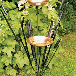 "Achla - Double Birdbath w Stand - Cattail Theme - Two elegant and radiant polished copper bowls stand amongst detailed and artful images of cattails made in iron, with powder coated black finish for weathering ability.  Ideal for either water or bird feed holding, perhaps one in each bowl.  Comes with its own iron stand. * 2 Polished copper bowlsBlack powdercoated iron stand12"" dia. bowls, 50""H"