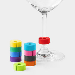 MoMA - MoMA Stemmarkers - Cleverly designed by Eric Janssen for MoMA, these colorful devices clip to the stems and rims of glasses so guests can keep track of which glass belongs to whom. Set of ten disks come stacked on a spool for convenient storage. Representing the Museum's commitment to exploring alternative materials, the Stemmarkers are made of non-toxic EVA foam, a soft substance celebrated in Mutant Materials in Contemporary Design, an exhibition organized and mounted by the Museum's Department of Architecture and Design.
