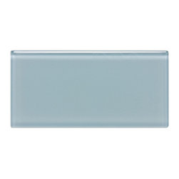 "Spa Glass - Blue Gray 3x6 Subway Glass Tile BOX - A soft Gray Blue Frosted 3X6 Glass Subway Tile with 3/8 thickness. Perfect for brightening any space, this is the ideal tile for a backsplash, kitchen tile or bathroom tile. The tiles are individual (not mesh mounted) which allows the designer to create any configuration like traditional subway, stacked horizontal, vertical, herringbone or even create your own blend of colors. These are a very high grade glass subway tile with a baked polypropolene backing reflecting the color back thru a very clear glass. The tiles are kilned at very high temperature to make these rated as a ""Pool Tile"" which makes the glass very durable and ideal for shower walls, wet areas and back splashes. Each piece is 3X6 and softly beveled. There are 8 pieces per square foot and the square foot price is $15.00. They come in boxes of 4 square feet or 32 pieces.The Price listed is for a single CARTON OF 4 SQUARE FEET. There is also a SAMPLE option so you can confirm the color is perfect for your space."