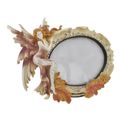 Fairy Tabletop 4 x 6 In. Oval Photo Picture Frame - At some point in their lives, every little girl dreams of becoming a beautiful fairy and spreading magic and joy throughout the world. This whimsical photo frame revives that fantasy by depicting a beautiful fairy holding a precious still-frame memory, a picture. This photo frame fits a 4 inch by 6 inch photo and is made of durable polyresin. The picture frame as an entity measures 11 inches long, 7.5 inches tall and is designed for tabletop display.
