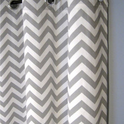 Blackout-lined Gray Zigzag Grommet Curtains by Designer Pillow Shop - These gray chevron curtains come with blackout liners, so your kids will (hopefully) sleep right through the crack of dawn. I can just see them paired with a painted turquoise curtain rod.