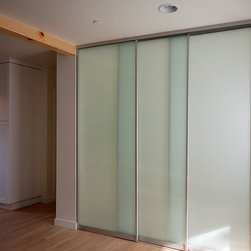 sliding door system - A raumplus sliding door system creates a division between the living room and office space, allowing for varying degrees of privacy, while light still enters the main space and entry at this contemporary Laguna Beach great room interior.