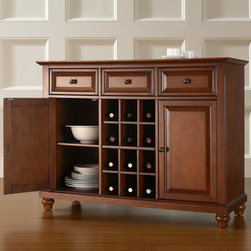 Crosley Furniture - Crosley Furniture Cambridge Buffet Server w/ Wine Storage in Classic Cherry - Constructed of solid hardwood and wood veneers, this Buffet Server / Sideboard Cabinet is designed for longevity. The beautiful raised panel doors & drawers, provide the ultimate in style to dress up your home. The three deep drawers provide an abundance of storage space. Behind the two doors, you will find adjustable shelves and storage space for things that you prefer to be out of sight. The center storage area is great for up to 12 bottles of wine, or if you prefer, remove the wine storage cubes to reveal an adjustable shelf. Style, function, and quality make this Buffet Server a wise addition to your home.