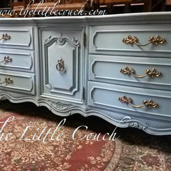 Custom Hand Painted Dressers - This refinished 9 drawer dresser is solid wood and has been painted in a beautiful Annie Sloan Provence Color. This beauty is distressed and has brassy gold Handles! This dresser is a French Provincial Style and was made by Thomasville. Its beautiful dramatic ornate design gives it that elegance. This would be a great addition to your home or office. Can be used as entertainment center, gust bedroom, dinning area or T.V Stand. It has been Sealed with Clear Wax for a great finish look. .