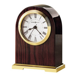 Howard Miller - Howard Miller Carter Table Top Clock - Howard Miller - Mantel / Table Clocks - 645389 - This contemporary table clock can be customized with an engraving plate to create a memento for your tabletop or wall. Distinguished by its polished brass tone dial bezel and base and classic white dial the Carter has a nice glow to it. Beautiful hardwood framing in a rosewood finish and quality quartz movement operation complete the look and appeal of this accent clock.